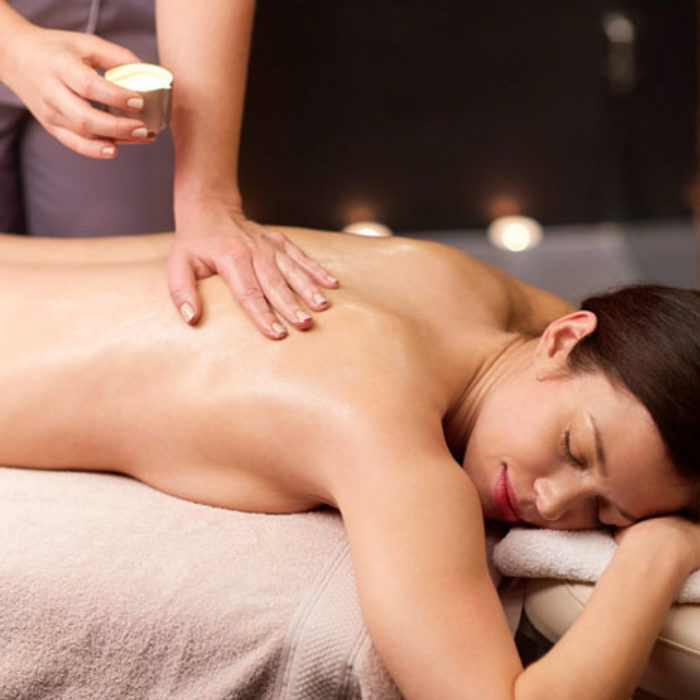 woman-lying-and-having-back-massage-at-spa-PJNQ87511